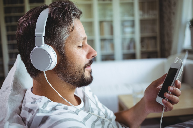 Man listening to music on headphones at home.jpeg